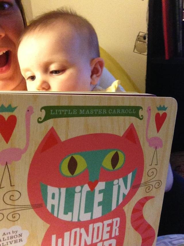 Baby Madeline reading the book I gave her!